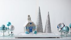 Design Director Anduin Havens shows how to create a magical, frost-filled landscape that can be used as a holiday display.Martha Stewart Living Holiday Frost house (Available in store only) Holiday Centerpieces, Candle Centerpieces, Christmas Decorations, Holiday Decor, Christmas Ornaments, Martha Stewart Christmas, How To Make Terrariums, Homemade Candles, Glitter Houses