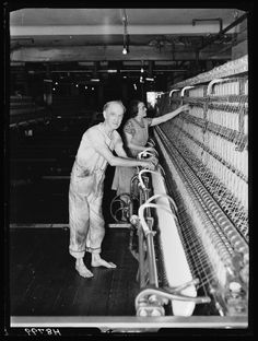 Mill worker, by Bishop Marshall, January 1940 for the Daily Herald.  Dressed in overalls he stands barefoot at a large loom. One of a series taken to illustrate a Daily Herald feature story by Dudley Barker on workers in wartime.