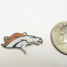 NFL Denver Broncos Bronco Head Logo DIY Charm Pendant . $2.99. Add a jump ring and hang it on your favorite piece of jewelry.