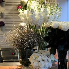 Roses, baby's breath, snapdragons, ranunculus