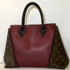 Authentic Louis Vuitton! 💝    ➡️No Trades⬅️ Authentic Louis Vuitton Monogram W PM Prunille. With LV dust bag & copy of Original Purchase Receipt. Finely crafted leather in purple for the main body with classic monogrammed toile canvas located at the side panels. The W-shaped bag allows expansive sides & can be worn wide or tucked in and snapped inwards securely with a hidden magnet closure. Brown suede interior with 2 hanging zippered pockets. Posh provides FREE Authentication for items…