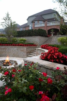 Retaining wall/Garden  This is fantastic and could be done in so many ways with a variety of retaining wall products: stone, brick, railroad ties, etc.