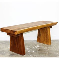 Featuring a straight back to be put against a wall, this beautiful, hand-carved acacia wood bench shows off natural edges of the wood in front where they can be viewed and admired for their naturally flowing lines and unique wood grain Golden Oak Oil.