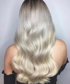 Sleek and silky silvery blonde balayage with warm and cool tones. Created by Wella Passionista Sharell Halpine.