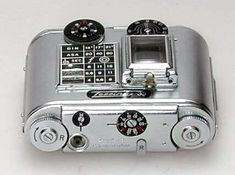 Tessina made by: CONCAVA. Year: 1960.This small camera uses 35mm film, spooled into special small cassettes.