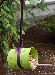 DIY Bird feeders from soup cans. I'd like some sort of block at the entrance so that all the seed doesn't pour out… but cute idea! :-D