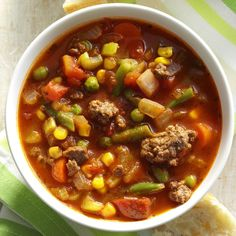 """Spicy Beef Vegetable Stew Recipe -""""This zesty ground beef and vegetable soup is flavorful and fast to fix,"""" reports Lynnette Davis of Tullahoma, Tennessee. """"It makes a complete meal when served with warm corn bread, sourdough bread or French bread. Slow Cooker Beef, Slow Cooker Recipes, Beef Recipes, Soup Recipes, Cooking Recipes, Dinner Recipes, Hamburger Recipes, Cabbage Recipes, Healthy Recipes"""