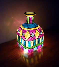Hand painted bottle light up art. Inspires me to make my own one day! Already got an LED base to light it up: http://www.flashingblinkylights.com/white-light-base-for-bottles-vase-up-lighting.html?utm_source=Pinterest&utm_medium=White%20LED%20Light%20Base%20for%20Bottles&utm_campaign=DIY%20Light%20Crafts