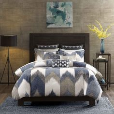 Spice up your bedroom with the INK+IVY Aspen Collection. Rich shades of navy and taupe play up this broken chevron motif for a casual update to your bedroom.