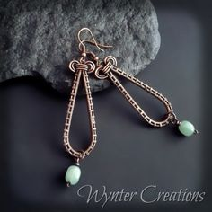 Long, elegant woven copper teardrops embellished with mint-green aventurine dangles. The Felicity earrings measure 7 cm l(about inches) long from top to bottom and 2 cm (about of an inch) across at the widest point, hung from copper-plated ear wires. Wire Jewelry Earrings, Paper Earrings, Wire Wrapped Earrings, Metal Jewelry, Beaded Earrings, Earrings Handmade, Beaded Jewelry, Jewlery, Artisan Jewelry