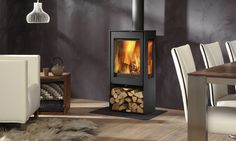 Kalle 3-sided wood stove. pete likes three sided, log store, flat front