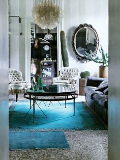 Grey, mother of pearl Panton lamp, velvet, teal, vintage (overdyed?) rugs and... cactii!