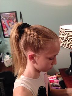 Gymnastics hairstyle Dutch braid