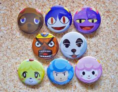 Animal Crossing button set! Less than $1 for each pin :). Tom Nook, Rover, Bob the Cat, K.K. Slider, Resetti, Cyrus, Isabelle & Reese #animalcrossing #acnl #gaming