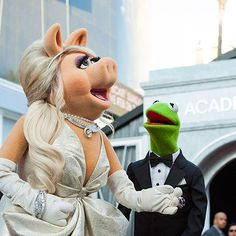 "Longtime loves Miss Piggy and Kermit the Frog enjoy a glamorous date night at the Academy Awards, where their film The Muppets took home Best Original Song for ""Man or Muppet."""