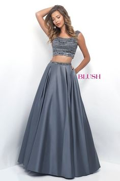 Two piece ball gown that features a fully beaded bodice, cap sleeves, and a scoop back. The box pleated skirt is crowned with a matching beaded belt.Back zipper closure.