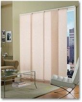 Sliding fabric room divider. Professionally made they are expensive, but perhaps could DIY one.