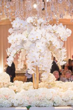 White Orchid Centerpiece with Floral Runners | Photography: Thisbe Grace Photography. Read More: http://www.insideweddings.com/weddings/gorgeous-tented-wedding-in-texas-with-neutral-gold-color-palette/677/