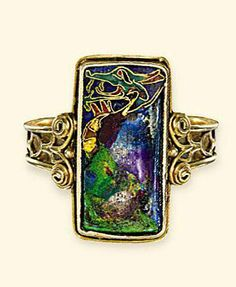 AN ARTS & CRAFTS GOLD AND ENAMEL RING   The rectangular-shaped panel decorated with a cloisonné enamel dragon to the polychrome ground with wirework shoulders and hoop, circa 1900