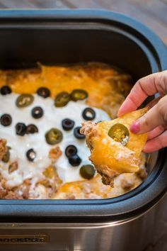 Slow Cooker Texas Trash Beef and Bean Dip This Slow Cooker Texas Trash Dip is extremely creamy and hearty, makes for the best game day dip! Slow Cooker Recipes, Crockpot Recipes, Cooking Recipes, Dip Crockpot, Slow Cooker Dips, Slow Cooker Appetizers, Hamburger Recipes, Crockpot Potluck, Crockpot Party Food