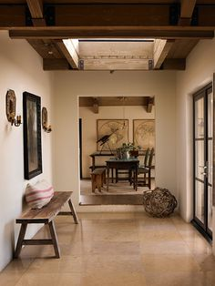 Earthy naturals reign supreme in the Dunn-Edwards color palette Back at the Ranch, which embodies the wild of the farm and desert. The white walls in this transitional area put exposed beams and other rustic details on display. Read Dunn-Edwards's 2016 color and design report here.