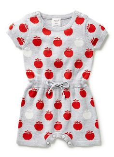 100% Cotton Bodysuit. Fully fashioned knit bodysuit with 1x1 rib finishes on short sleeves, neck and hem. Ribbed waist with drawcord, button closures on shoulder line, and inside leg. Features all over apple intarsia, available in colour shown.
