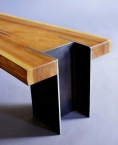 Wooden bench with metal legs