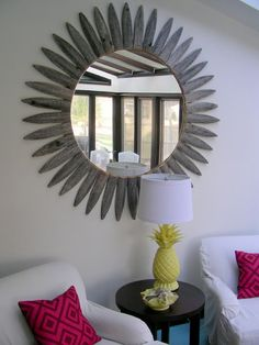 Mirrors are the simplest way to make any space feel bigger and lighter. Gorgeous Shiny Things made this mirror's frame from an old picket fence tips. Clever!