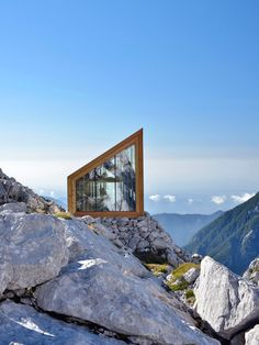 Airlifted into position by the Slovenian army, this tiny Alpine shelter perches on a rocky outcrop below Skuta Mountain and can sleep up to eight mountaineers