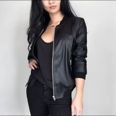 "•LAST ITEM•""Black Matte Leather Jacket"" Gorgeous faux matte leather jacket. Made very well, double layered with a soft fabric inside. Along with side zippers. I actually bought this for my self  and decided to stock a few for everyone. Get my full look & pair this with my racer tank, wax denim & dainty gold feather necklace.  Modeling: Small Material: Cotton, Polyester & PU Fit: True to Size, not to tight but also not too big, fitted cut.   ( Please do not purchase this listing, I will…"