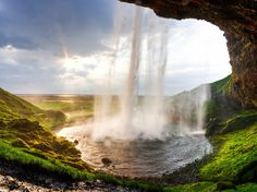 Seljalandsfoss looks great at any angle, but it's worth the hike to see the waterfall from the cave behind it. Can someone commission an Airbnb property here please?