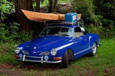 Volkswagen Karmann Ghia with canoe and a cooler