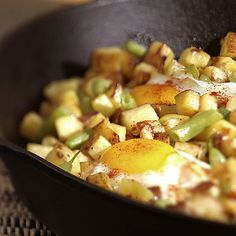 Here's an easy one-pan meal that will get the entire family gathered around the breakfast or brunch table in a flash. It's a healthier take on the typical eggs-and-potatoes meal, which will satisfy you but may leave you feeling sluggish and too full for hours afterward. In this case, fresh or canned green beans lighten