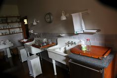The wash-up area is across from the stoves.  The two enameled sinks are original to the house. 1925 Ford estate