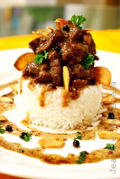 http://pinterest.com/ronleyba/filipino-recipes-philippine-foods-filipino-dish/ Pork Adobo with Fried Garlic Chips ----   Very popular Filipino dish(Photo)