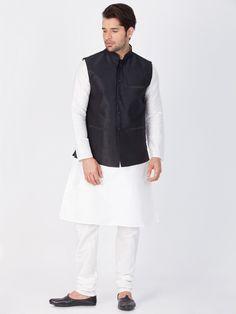Buy White Kurta Pajama With Black Jacket Online from Bodylinestore at best price. Select a wide range of designer kurta pajama with jacket, pathani suit for men, wedding kurta, ethnic kurta set, sangeet kurta & more. Churidar, Men Dress Up, White Kurta, Jackets Online, Mens Suits, Frocks, Normcore, Pajamas, Diwali
