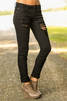 Black, shredded denim! Perfect for an edgy look or a night out!