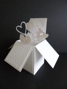 Pop-Up Box ~ Wedding (make as centre piece perhaps with pearl string coming out of the box too.  Plus, put an assortment of foil punch outs around the box.
