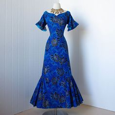 """I love trave7's description on this one.""""1950's surfriders sportswear classic blue hawaiian print cotton mermaid wiggle bombshell dress with gold screened embellishment"""""""