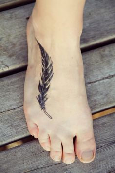 Feather tattoo. nice placement