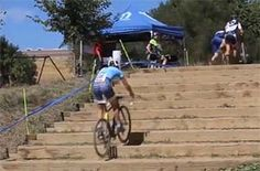Cyclo-cross rider overcomes stairs by hopping. Click for pic video.