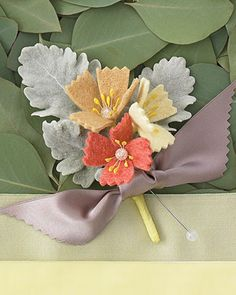 Boutonniere with Felt Flowers    Felt flowers and dusty-miller leaves wrapped in double-face satin ribbon