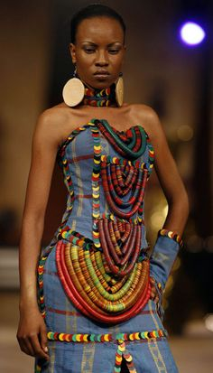 """""""... vulcanite beads/heishi (from the African trade period) that have been integrated into this dress by Nigerian designer Adegbe 