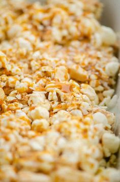 Looking to step up your movie night? You need to try these caramel apple popcorn bars!! Oooey, gooey cinnamon apple flavor mixed with coconut flakes and some caramel.