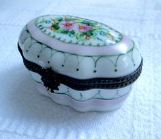A Beautiful Antique Hand Painted Limoges France Porcelain Trinket Box with delicate pink and green flowers. This beautiful French Limoges box