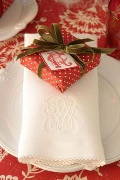 Red and white polka dot wrap with green velvet ribbon, monogrammed linens - Carolyne Roehm by marjorie
