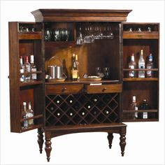 Converted armoire bar? (@Mizani Designs - If you needed to make us a bigger piece to get rid of our clutter? haha...)