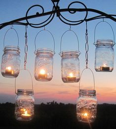 Great Idea for a backyard BBQ or outdoor party :) Even saw these hanging from trees at an outdoor wedding reception. So cute! All you need is some mason jars, votives and sturdy wire.
