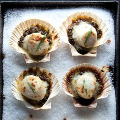 """Coquilles St-Jacques (Gratineed Scallops) Recipe -Although coquilles St-Jacques simply means """"scallops"""" in French, in the idiom of American cooks, the term is synonymous with the old French dish of scallops poached in white wine, placed atop a purée of mushrooms in a scallop shell, covered with a sauce made of the scallop poaching liquid, and gratinéed under a broiler. - Saveur.com Food Design, Seafood Recipes, Cooking Recipes, Clam Recipes, La Trattoria, Coquille St Jacques, Gratin Dish, Good Food, Yummy Food"""