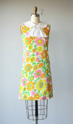 Iv been looking at designs from the 60s are in the style of it. The bright colours in this dress tell me its from that time.